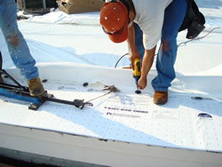 another-commercial-roof-repair-men-on-the-roof
